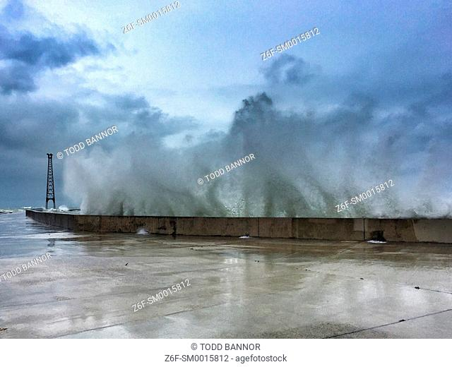 A wave crashes into the seawall at Montrose Point. Chicago, Illinois