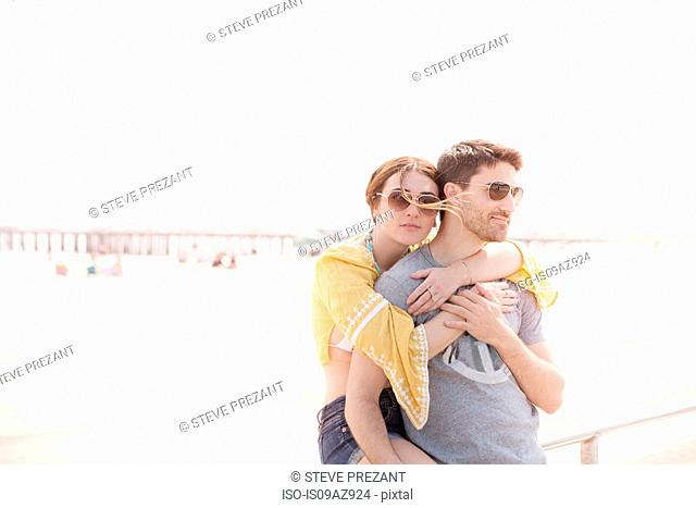 Couple by beach hugging, Coney island, Brooklyn, New York, USA