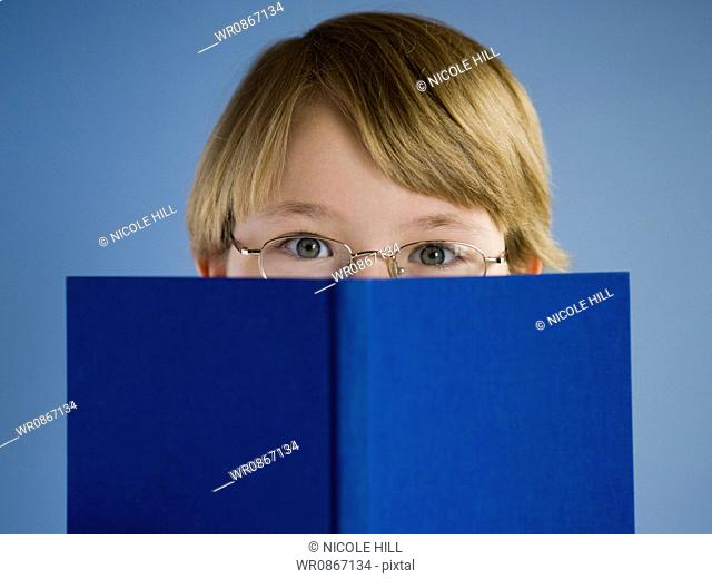 Boy with hardcover book