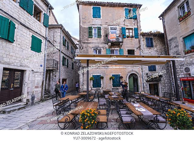 Small square with restaurant on the Old Town of Kotor coastal city, located in Bay of Kotor of Adriatic Sea, Montenegro
