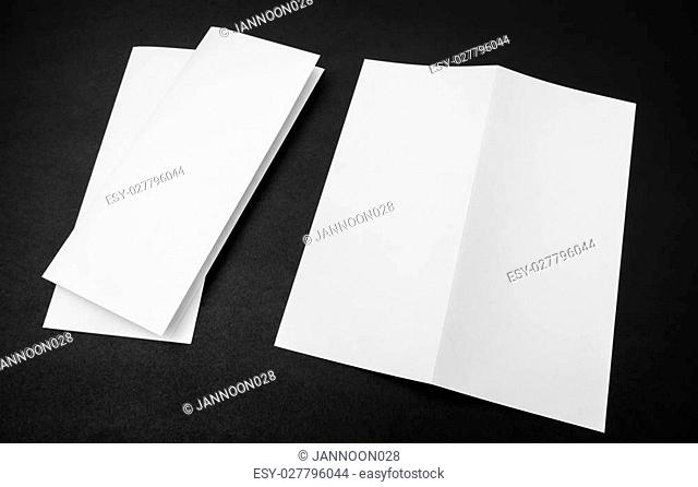 Bifold white template paper on black background
