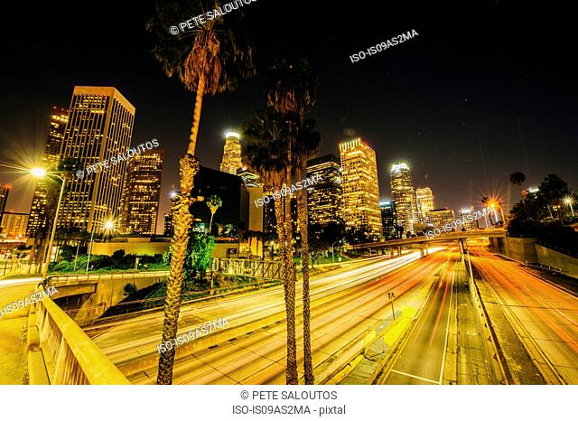 View of city skyline and highway at night, Los Angeles, California, USA
