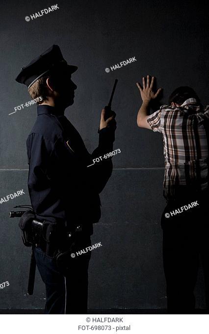 A police officer arresting a criminal