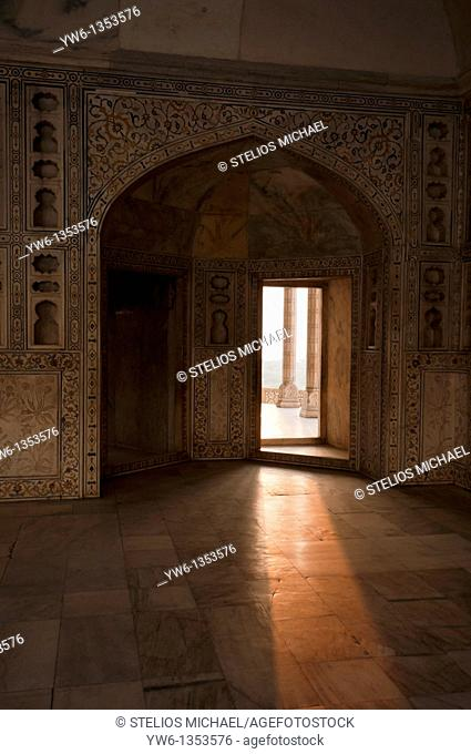 The interior of the Khas Mahal in Arga Fort during sunrise  The faint outline of the Taj Mahal can be seen in the distance