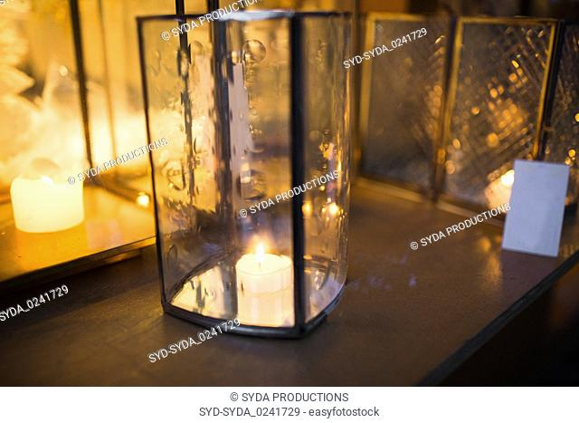 close up of lantern with candle burning inside
