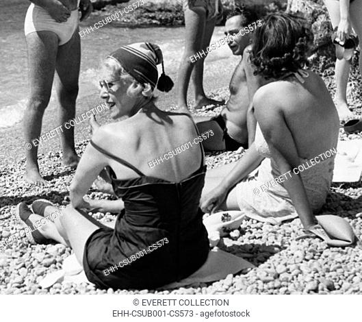 Clare Booth Luce (wearing hat) relaxes with friends at the Beach on Capri Island, Italy. Aug. 28, 1953. She served as U.S