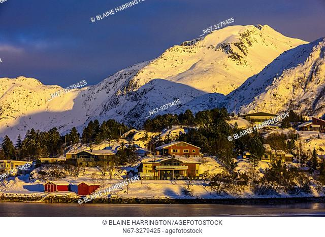 Houses surrounded by snow covered mountains, Svolvaer, on Austvagoya Island, Lofoten Islands, Arctic, Northern Norway