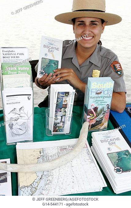 Information, female ranger. Earth Day Expo. Lummus Park. Miami Beach. Florida. USA