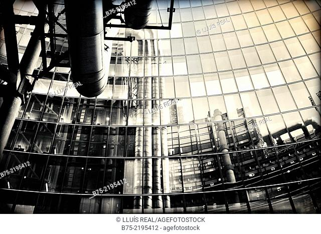 Reflections of Lloyds Bank building in the windows of Willis Building in the city of London, England, UK