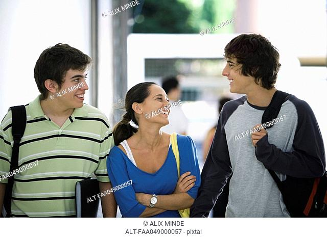College students walking and chatting together
