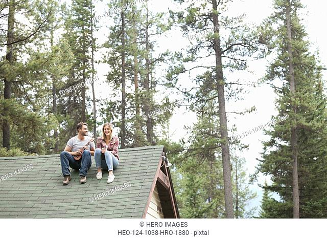 Young couple sitting on resort roof