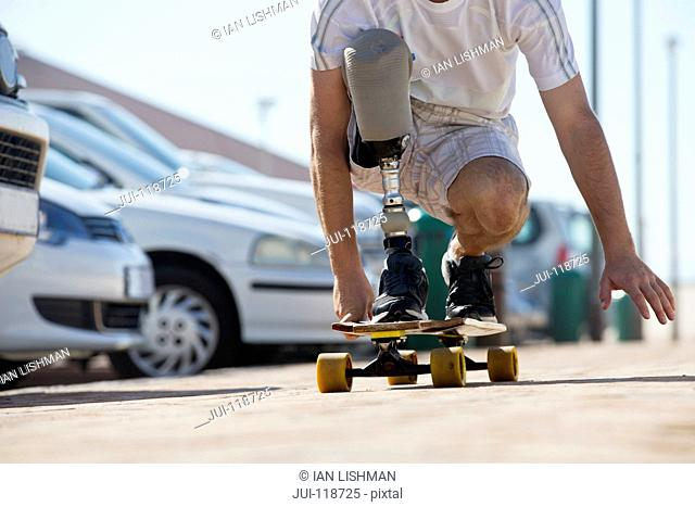Close Up Of Man With Artificial Leg Using Skateboard