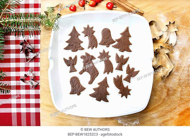 Preparing gingerbread cookies for christmas. Steps of making biscuits
