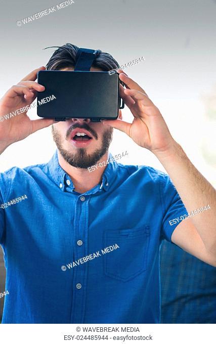 Close-up of man using virtual reality glasses