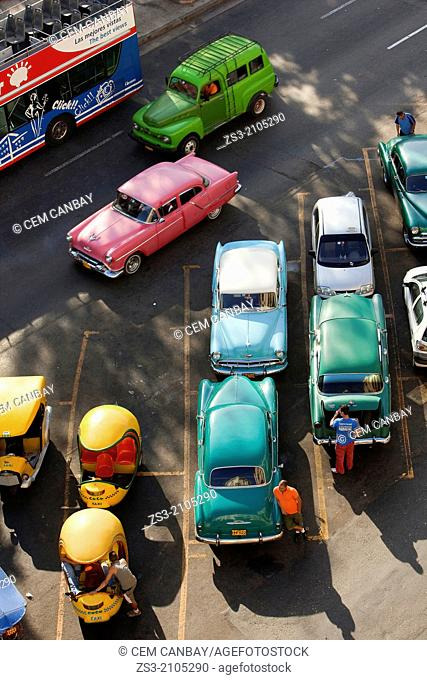 Old american cars and Coco Taxis parked at the street, Havana, Cuba, West Indies, Central America