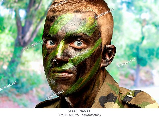 portrait of a mad soldier against a nature background
