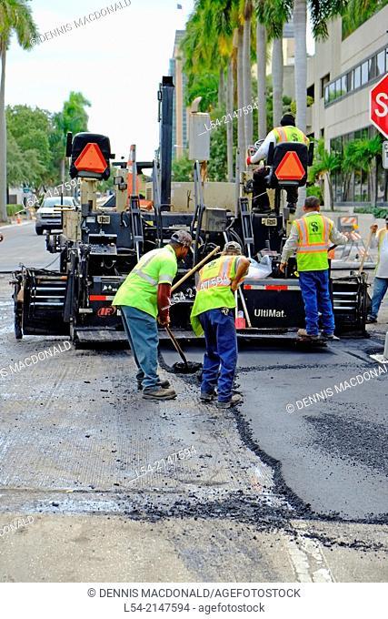 Asphalt paving of a street using heavy equipment