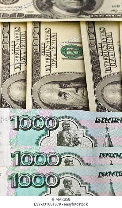 Russian rubles and US dollars. Background