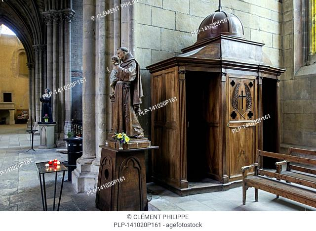 Old wooden sculptures and confessional box in the Nevers Cathedral / Cathédrale Saint-Cyr-et-Sainte-Julitte de Nevers, Burgundy, France