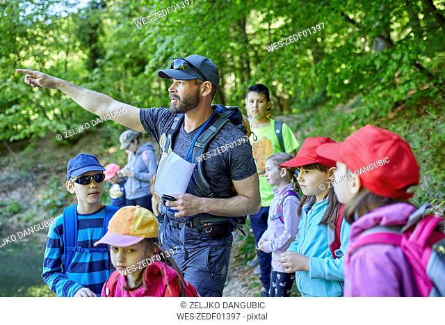 Man talking to kids on a field trip in forest