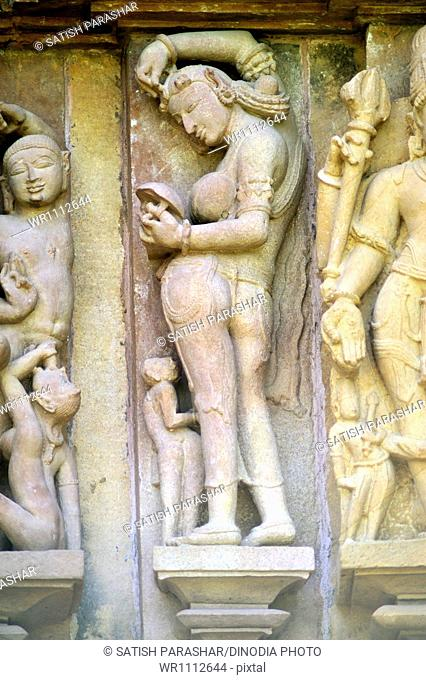 Khajuraho graceful apsara filling kumkum lakshmana temple madhya pradesh india