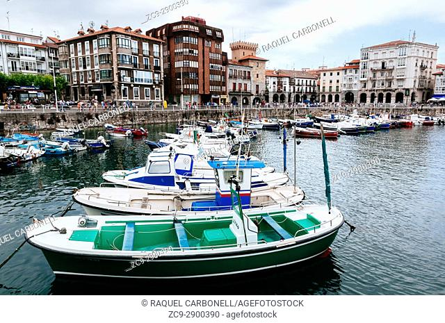 Boats moored at the port with typical houses at back, Castro Urdiales, Cantabria, Spain