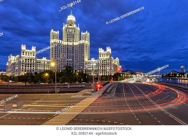 Residential high-rise building on Kotelnicheskaya Embankment illuminated at dusk. Moscow, Russia