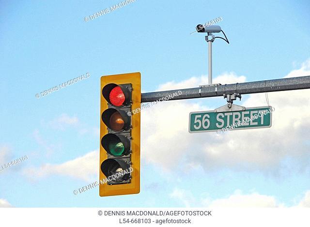 Traffic signal light with camera photographing traffic violations violators ticket record proof capture