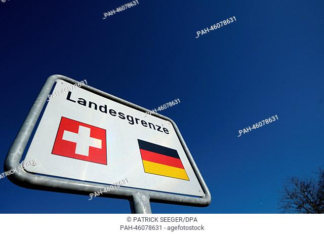 A road sign which indicates the nearby border crossing between Germany and Switzerland stands in Loerrach, Germany, 6 February 2014