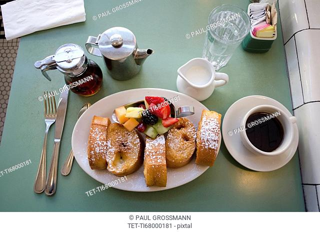 Plate with fresh french toasts and fruits