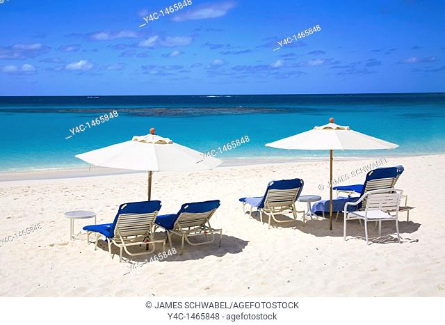 Chairs and umbellas on Shoal Bay East Beach on the caribbean island of Anguilla in the British West Indies