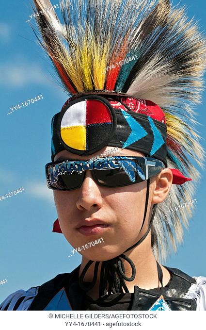 Young Blackfoot boy in traditional regalia and sunglasses, Siksika Nation Pow-wow, Gleichen, Alberta, Canada