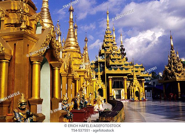 Shrines of the Shwedagon pagoda in the evening light. Yangoon, Myanmar