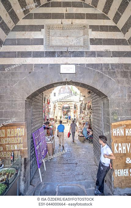 Gate of Hasan Pasha Khan,a medieval inn used for cafes and small shops now in Diyarbakir,Turkey. 16 July 2018