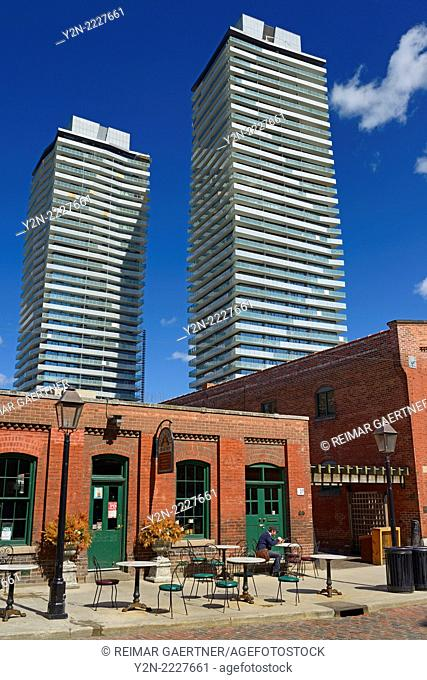 Outdoor patio at bakery in Historic Distillery District Toronto with condo highrise towers