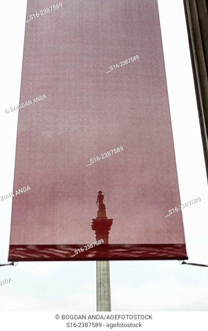 London, UK, Trafalgar Square - Nelson's Column seen through a textile banner hanging in front of the National Portrait Gallery (NPG)