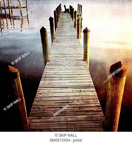 An empty dock on the river