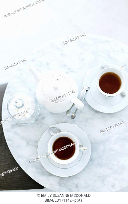 High angle view of cups of coffee on table
