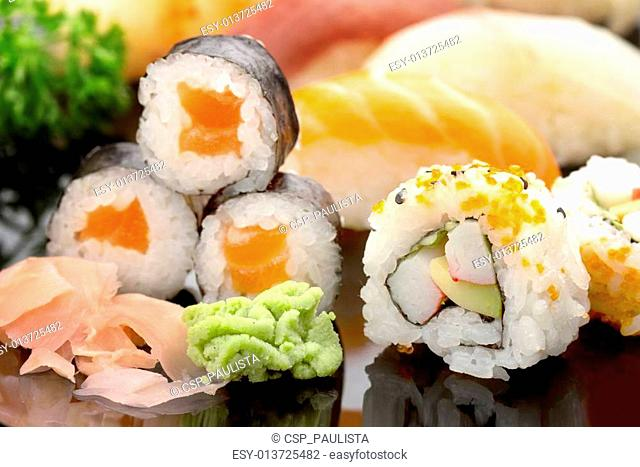 sushi on black glass dish