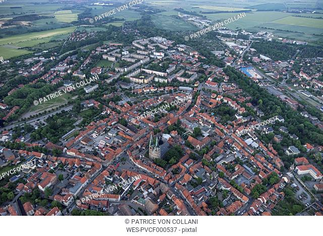 Germany, aerial view of Quedlinburg with St. Nicolas' Church in the evening