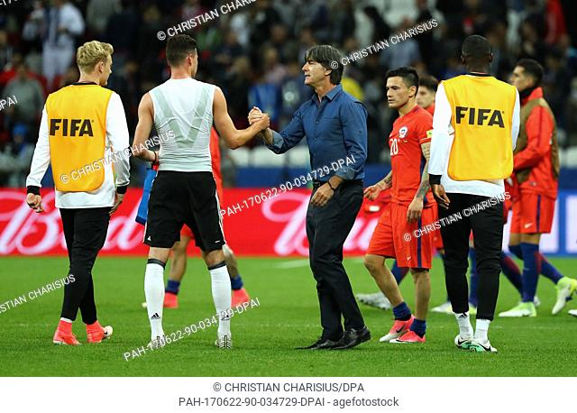 Germany's manager Joachim Loew (C) thanks Julian Draxler at the end of the Confederations Cup group stages Group B soccer match between Germany and Chile in...
