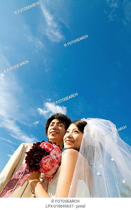 Bride and bridegroom smiling cheek to cheek