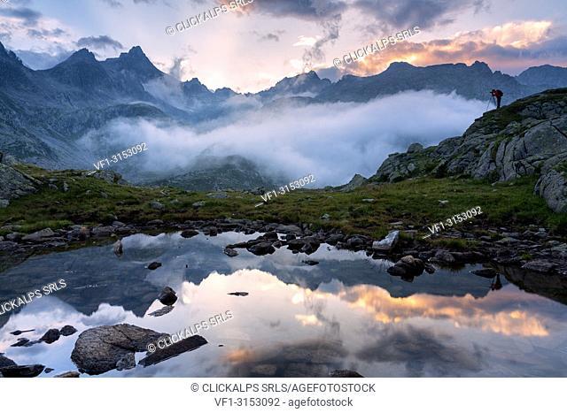 The photographer, Adamello Brenta Natural park in Trentino alto Adige, Italy