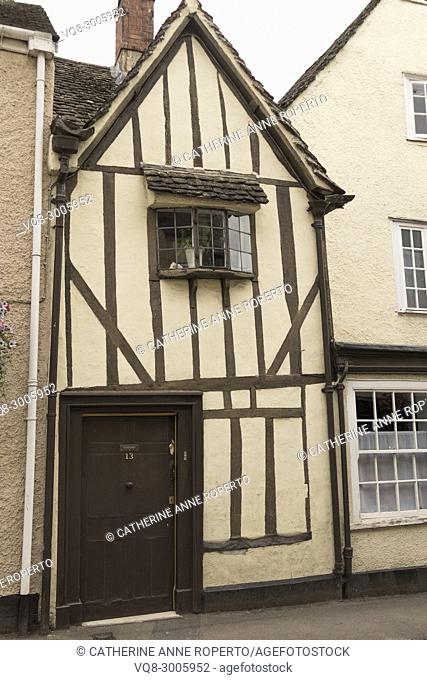 Brown and cream traditional medieval timber framed house in Tewkesbury, Gloucestershire, England