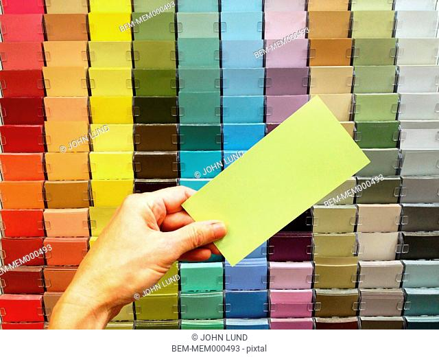 Caucasian woman examining paint swatches