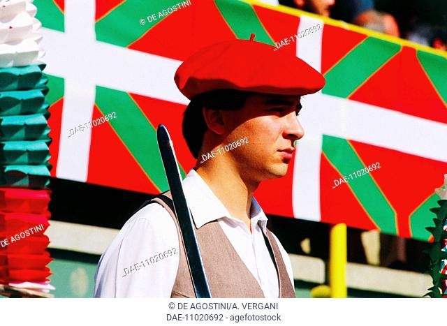 Young man in traditional costume at the Basque wood-chopping competition (aizkolari), Basauri, Basque Country, Spain
