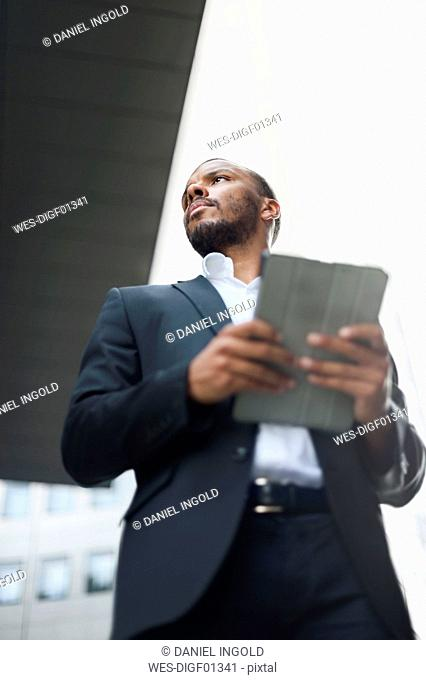 Serious businessman with tablet