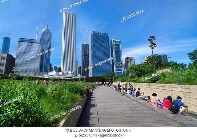 Chicago Illinois Millennium Park in Lurie Gardens with skyline in background skyscrapers in downtown Midwest city and tourists