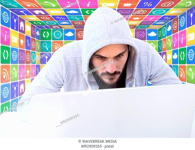 Man in hood on laptop in front of icons