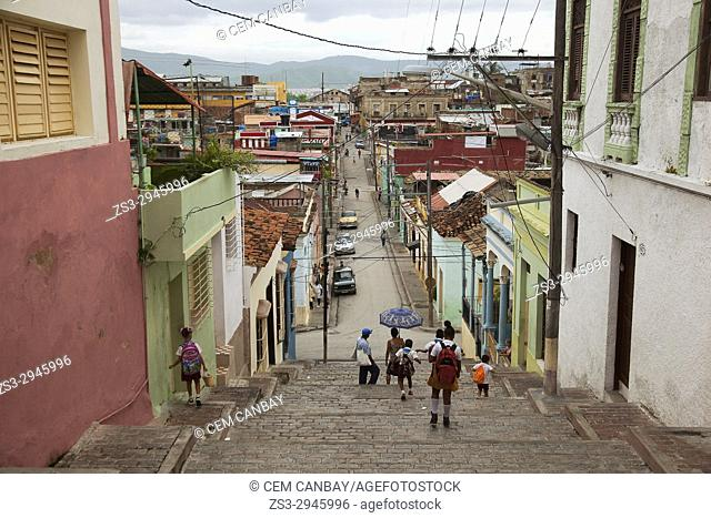 Local people and school children wearing uniforms at the Padre Pico steps in the historic town centre at the Tivoli district, Santiago de Cuba, , Cuba